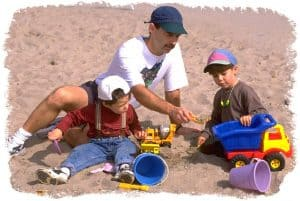 father-and-boys-playing